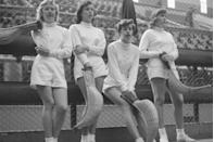 <p>A group of high school girls stand on the sidelines during a break from playing jai alai. </p>