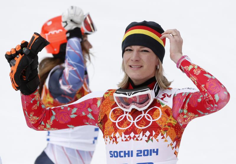 Germany's Maria Hoefl-Riesch reacts after winning the gold medal in the women's supercombined at the Sochi 2014 Winter Olympics, Monday, Feb. 10, 2014, in Krasnaya Polyana, Russia. (AP Photo/Christophe Ena)