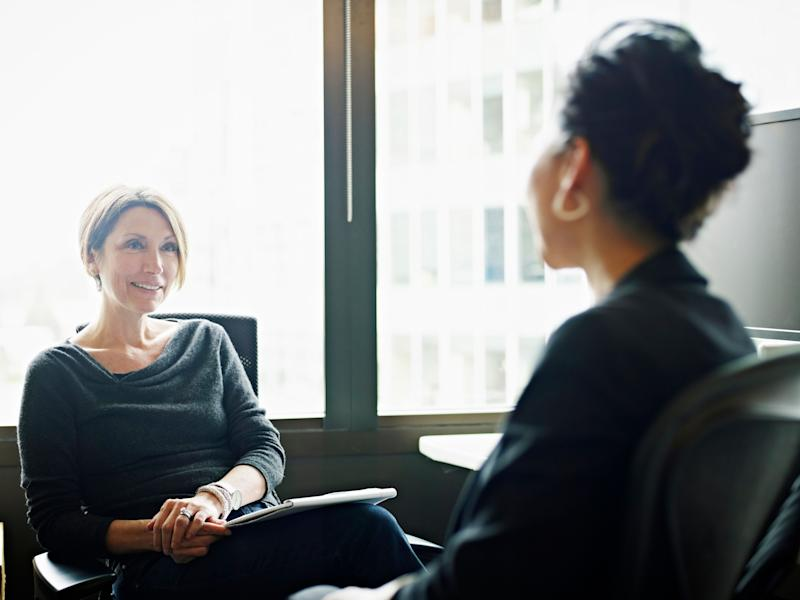 Businesswomen in discussion at workstation in office