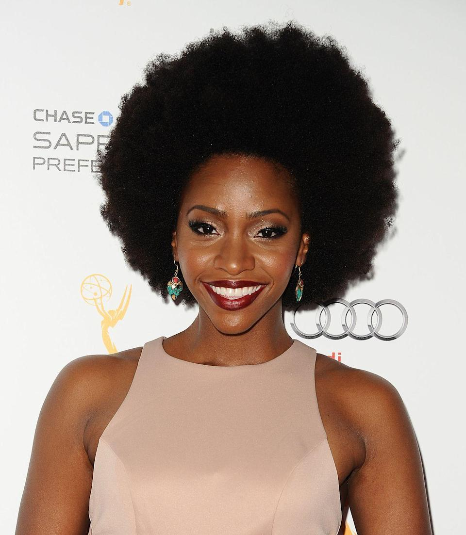 <p>Afros are timeless and head-turning. To get a voluminous look like actress <strong>Teyonah Parris</strong>, use a wide tooth hair pick to comb out your curls until you've achieved the volume and shape you want. </p>