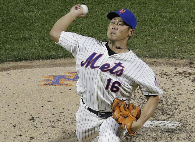 New York Mets' Daisuke Matsuzaka, of Japan, delivers a pitch during the fourth inning of a baseball game against the Detroit Tigers Friday, Aug. 23, 2013, in New York. (AP Photo/Frank Franklin II)