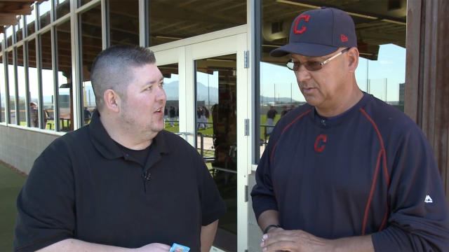 Terry Francona opening 25-year-old baseball cards. (Yahoo Sports)