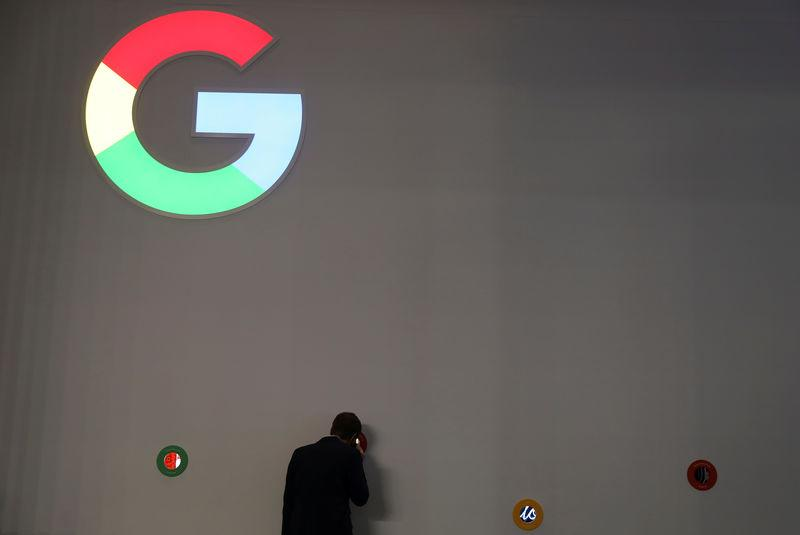 A man checks Google devices outside its booth at the Mobile World Congress in Barcelona