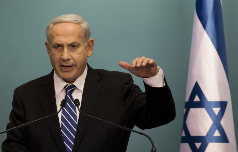 Israeli Prime Minister Benjamin Netanyahu speaks during a press conference at the Prime Minister's office in Jerusalem, Tuesday, Oct. 9, 2012. Netanyahu has ordered new parliamentary elections in early 2013, roughly eight months ahead of schedule. (AP Photo/Bernat Armangue)