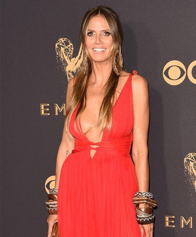 Heidi's loose gown struggled to cover her assets. Photo: Getty