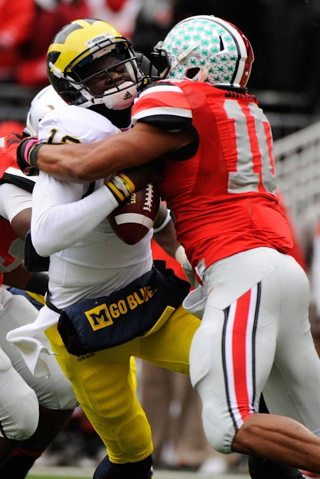 COLUMBUS, OH - NOVEMBER 24: Ryan Shazier #10 of the Ohio State Buckeyes sacks quarterback Devin Gardner #12 of the Michigan Wolverines in the first half at Ohio Stadium on November 24, 2012 in Columbus, Ohio. (Photo by Jamie Sabau/Getty Images)