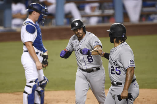 Colorado Rockies' Matt Kemp (25) congratulates Josh Fuentes (8) on his two-run home run as Los Angeles Dodgers catcher Will Smith looks on during the second inning of a baseball game in Los Angeles, Sunday, Sept. 6, 2020. (AP Photo/Kelvin Kuo)