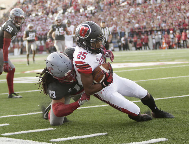 Washington State linebacker Jahad Woods (13) tackles Utah wide receiver Jaylen Dixon (25) during the first half of an NCAA college football game in Pullman, Wash., Saturday, Sept. 29, 2018. (AP Photo/Young Kwak)