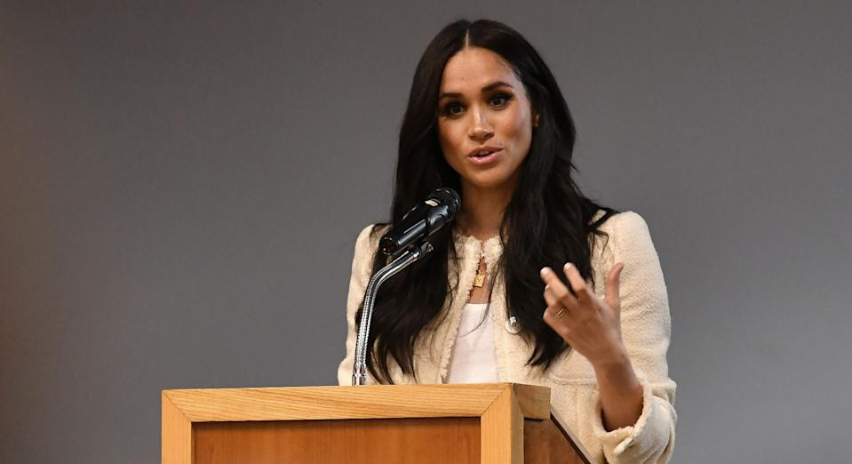 """Meghan Markle wore a """"good fortune"""" charm necklace for an International Women's Day school visit [Image: Getty]"""