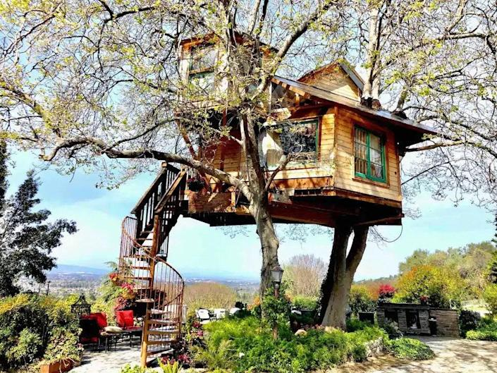 """<p><strong>San Jose, California</strong></p> <p>Views, views, and more views will be your first impression upon ascending the wood spiral staircase of the San Jose Treehouse and entering its well appointed 250 square feet. The space features two lofts and two bedrooms, complete with air-conditioning, that overlook the vast Silicon Valley. You can gaze out through the stained glass windows while taking in the ingenious sycamore trees that support and frame the house.</p> $358, Airbnb. <a href=""""https://www.airbnb.com/rooms/25671493"""" rel=""""nofollow noopener"""" target=""""_blank"""" data-ylk=""""slk:Get it now!"""" class=""""link rapid-noclick-resp"""">Get it now!</a>"""