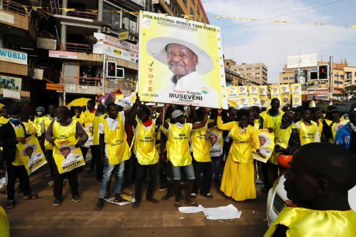 Polling agents from the National Resistance Movement (NRM) party celebrate the victory of Uganda's President Yoweri Museveni in the concluded general elections in Kampala