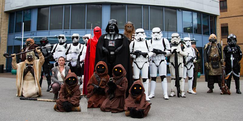 Doncaster racecourse, Doncaster, UK - October 7, 2018. A group of cosplayers dressed as characters from the Star Wars movies including Darth Vader, Stormtroopers, Chewbacca and Jawas at a comic con in Doncaster, UK.