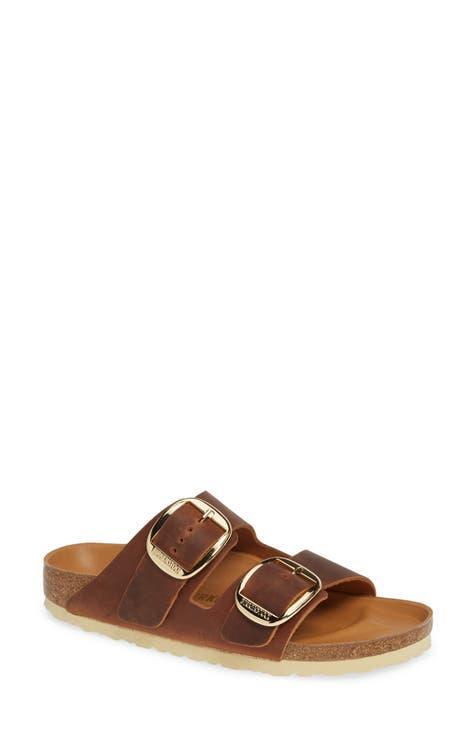 """<h3>Birkenstock Arizona Hex Sandal</h3><br>""""[This is] my fourth pair of [the] Arizona style over the last 20 years,"""" wrote a diehard comfort-footwear fan on Nordstrom.com. """"These are more narrow and lighter than my older pairs but soo comfortable! I just put the tightest setting on the buckle but I have a narrow size 9 foot. I ordered a 40 and it is perfect. I got the oiled cognac leather with gold buckles — [a] great neutral to go with everything!""""<br><br><em>Shop <strong><a href=""""https://www.nordstrom.com/brands/birkenstock--86"""" rel=""""nofollow noopener"""" target=""""_blank"""" data-ylk=""""slk:Birkenstock"""" class=""""link rapid-noclick-resp"""">Birkenstock</a></strong></em><br><br><strong>Birkenstock</strong> Arizona Hex Slide Sandal, $, available at <a href=""""https://go.skimresources.com/?id=30283X879131&url=https%3A%2F%2Fwww.nordstrom.com%2Fs%2Fbirkenstock-arizona-hex-slide-sandal-women%2F5930959%3F%26color%3Dantique%2520cognac%2520oiled%2520leather"""" rel=""""nofollow noopener"""" target=""""_blank"""" data-ylk=""""slk:Nordstrom"""" class=""""link rapid-noclick-resp"""">Nordstrom</a>"""