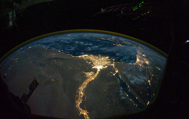 From 220 miles above Earth, one of the Expedition 25 crew members on the International Space Station took this night time photo featuring the bright lights of Cairo and Alexandria, Egypt on the Mediterranean coast. The Nile River and its delta stand out clearly as well. On the horizon, the airglow of the atmosphere is seen across the Mediterranean. The Sinai Peninsula, at right, is outlined wit