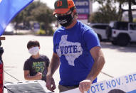 A supporter of Democratic presidential candidate former Vice President Joe Biden prepares for a Ridin' With Biden event Sunday, Oct. 11, 2020, in Plano, Texas. Democrats in Texas are pressing Joe Biden to make a harder run at Texas with less than three weeks until Election Day. (AP Photo/LM Otero)