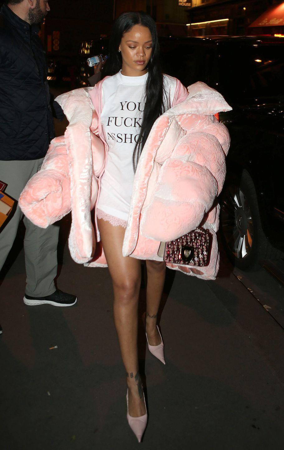 "<p>In a Vetements ""You Fuck'n Asshole"" t-shirt, lace shorts, a pink cardigan, a massive pink puffer jacket by Ella Boucht, a Dior bag and pointed-toe shoes in Paris.</p>"