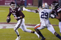 Mississippi State quarterback Will Rogers (2) scrambles away from Auburn linebacker Derick Hall (29) during the first half of an NCAA college football game Saturday, Dec. 12, 2020, in Starkville, Miss. (AP Photo/Rogelio V. Solis)