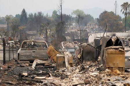 A charred neighborhood destroyed by the Carr Fire is seen west of Redding California