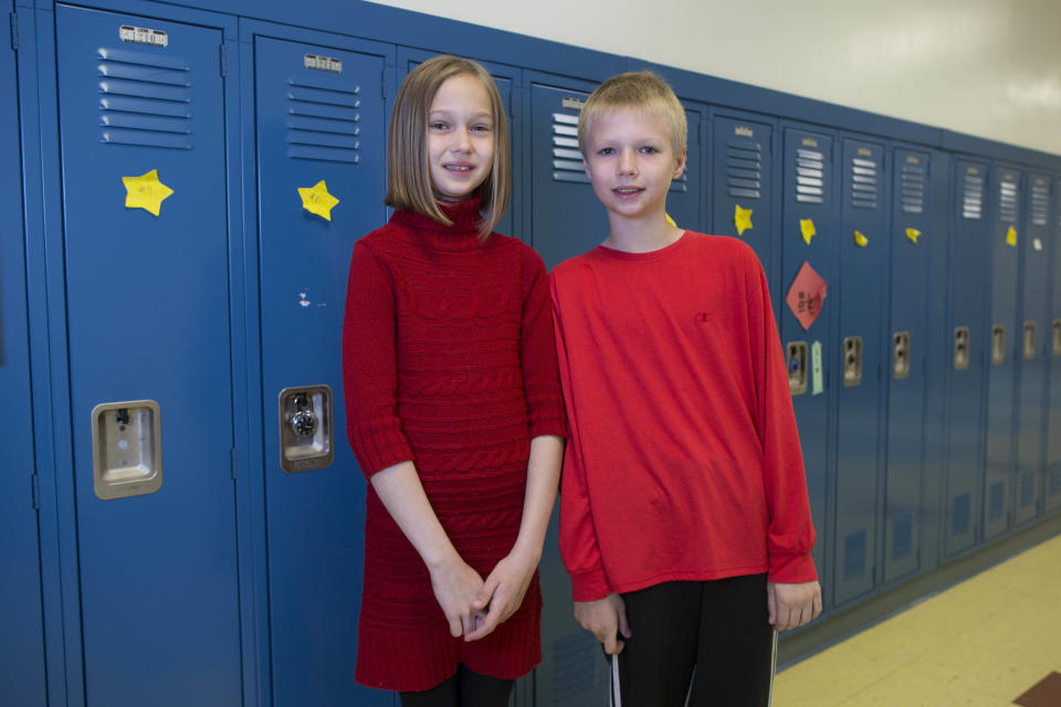 In this Thursday, June 6, 2013 photo, Kira Noe, left, and her twin brother, Silas, one of the 24 sets of twins from Highcrest Middle School in Wilmette, Ill., pose for a portrait at the school. The group is attempting to break a Guinness World record for the amount of twins in one grade which is currently 16 sets. (AP Photo/Scott Eisen)