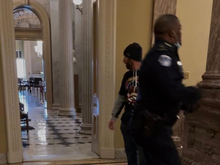 <p>A police officer, identified as Eugene Goodman, has been hailed a hero after distracting a pro-Trump mob from the entrance to the US Senate chambers during Wednesday's riots</p> (Twitter)