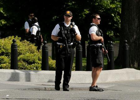 FILE PHOTO: Secret Service agents stand guard after a shooting incident near the White House in Washington DC