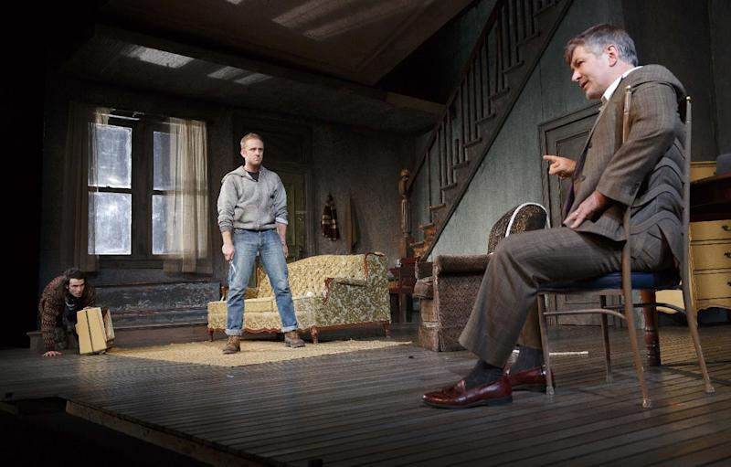 "This theater image released by Boneau/Bryan-Brown shows, from left, Tom Sturridge, Ben Foster and Alec Baldwin during a performance of ""Orphans,"" at the Gerald Schoenfeld Theatre in New York. (AP Photo/Boneau/Bryan-Brown, Joan Marcus)"