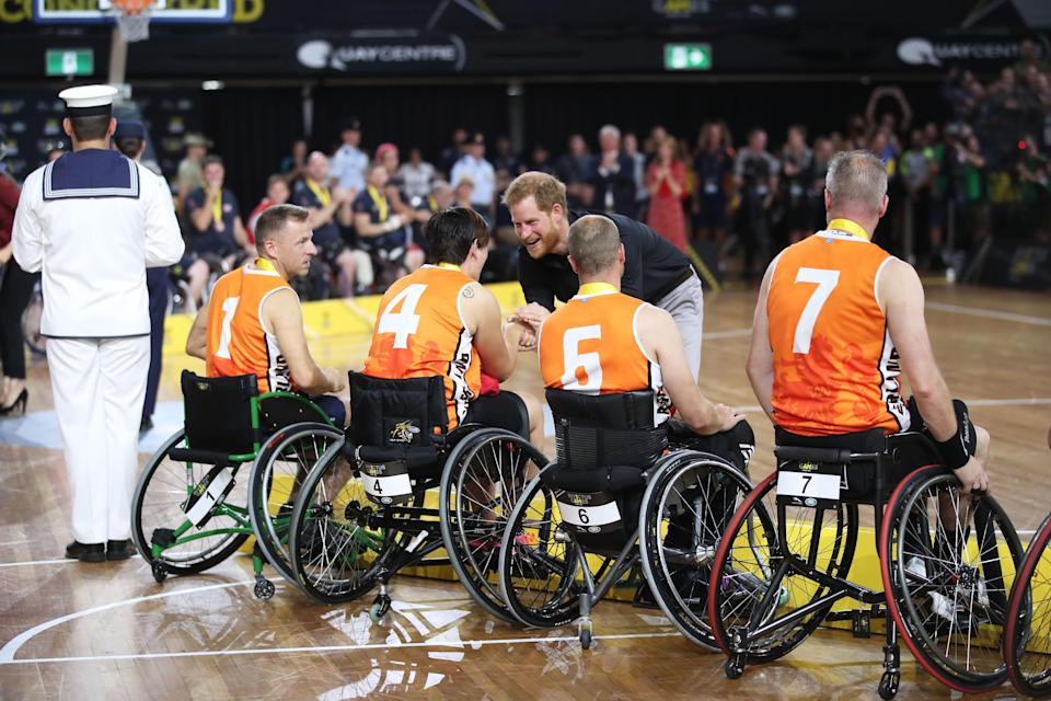 The The Duke of Sussex congratulates the silver medallists after the Wheelchair Basketball gold medal match during the Invictus Games in Sydney in 2018