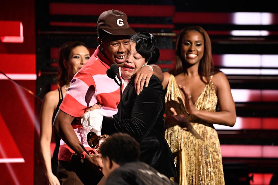 Tyler, the Creator embraces his mother as he accepts the award for best rap album at the Grammy Awards.