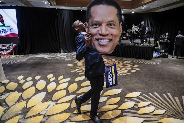Costa Mesa, CA, Tuesday, September 14, 2021 - Errol Webber of Costa Mesa parades a cutout picture of Larry Elder at the candidates' election party at the Orange County Hilton. (Robert Gauthier/Los Angeles Times)