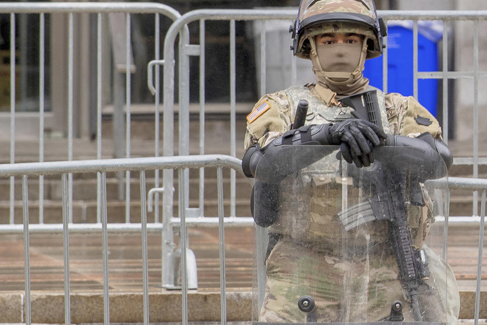 A member of the National Guard stands guard in front of the Philadelphia Municipal Services Building in Philadelphia, Pa., Friday, Oct. 30, 2020. (Jose F. Moreno/The Philadelphia Inquirer via AP)