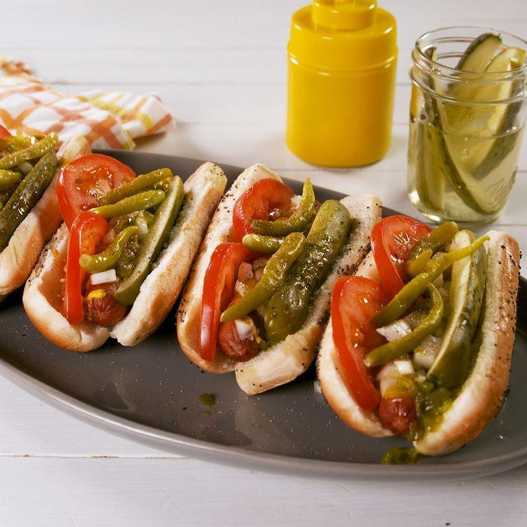 "<p>This classic recipe for Chicago dogs will instantly transport you to the beloved midwestern city. Poppy seed buns are a must!</p><p><strong><em>Get the recipe at <a href=""https://www.delish.com/cooking/recipe-ideas/a27962694/chicago-style-hot-dogs-recipe/"" rel=""nofollow noopener"" target=""_blank"" data-ylk=""slk:Delish"" class=""link rapid-noclick-resp"">Delish</a>. </em></strong></p><p>__________________________________________________________</p><p><em>Want more recipes? You're in luck! <a href=""https://subscribe.hearstmags.com/subscribe/womansday/253396?source=wdy_edit_article"" rel=""nofollow noopener"" target=""_blank"" data-ylk=""slk:Subscribe to Woman's Day"" class=""link rapid-noclick-resp"">Subscribe to Woman's Day</a> today and get <strong>73% off your first 12 issues</strong>. And while you're at it, <a href=""https://subscribe.hearstmags.com/circulation/shared/email/newsletters/signup/wdy-su01.html"" rel=""nofollow noopener"" target=""_blank"" data-ylk=""slk:sign up for our FREE newsletter"" class=""link rapid-noclick-resp"">sign up for our FREE newsletter</a> for even more of the Woman's Day content you want.</em></p>"