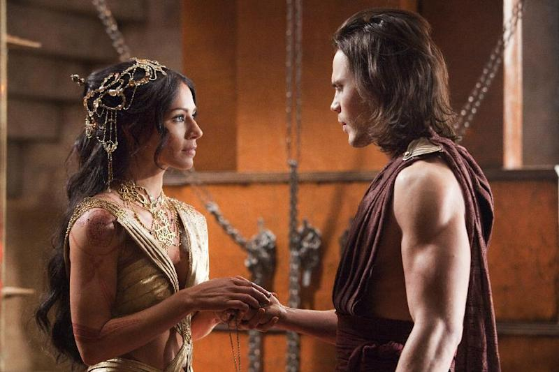 """In this film image released by Disney, Lynn Collins portrays Dejah Thoris, left, and Taylor Kitsch portrays John Carter in a scene from """"John Carter."""" (AP Photo/Disney, Frank Connor)"""