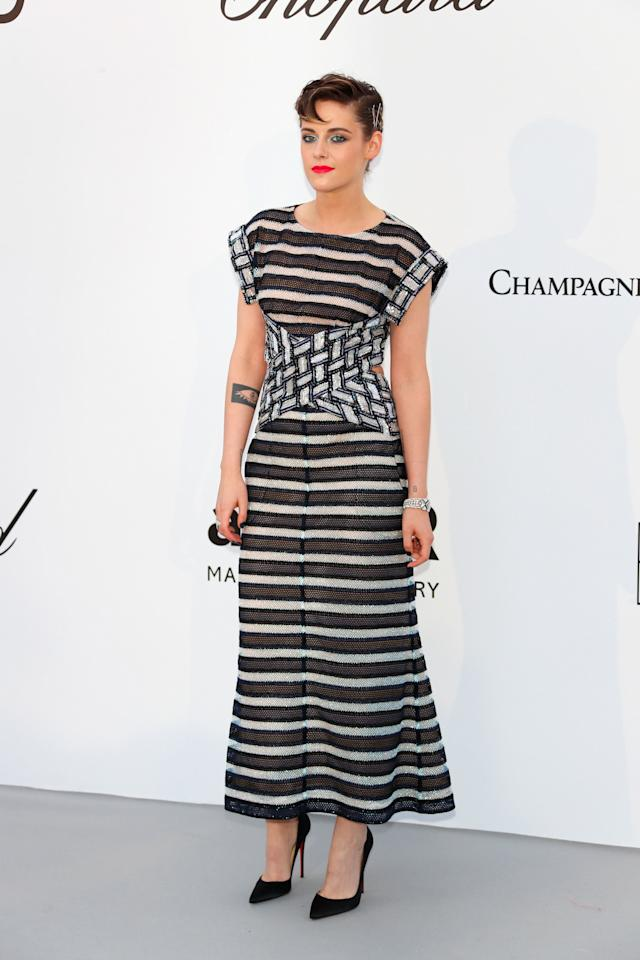 <p>Kristen Stewart saved her best look until last, as she donned monochrome Chanel stripes at the amfAR Gala during Cannes Film Festival. [Photo: Getty] </p>