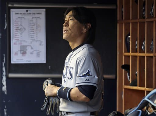 Tampa Bay Rays' Hideki Matsui looks over the field from the dugout after batting during the second inning of a baseball game against the New York Yankees at Yankee Stadium in New York, Tuesday, June 5, 2012. (AP Photo/Seth Wenig)