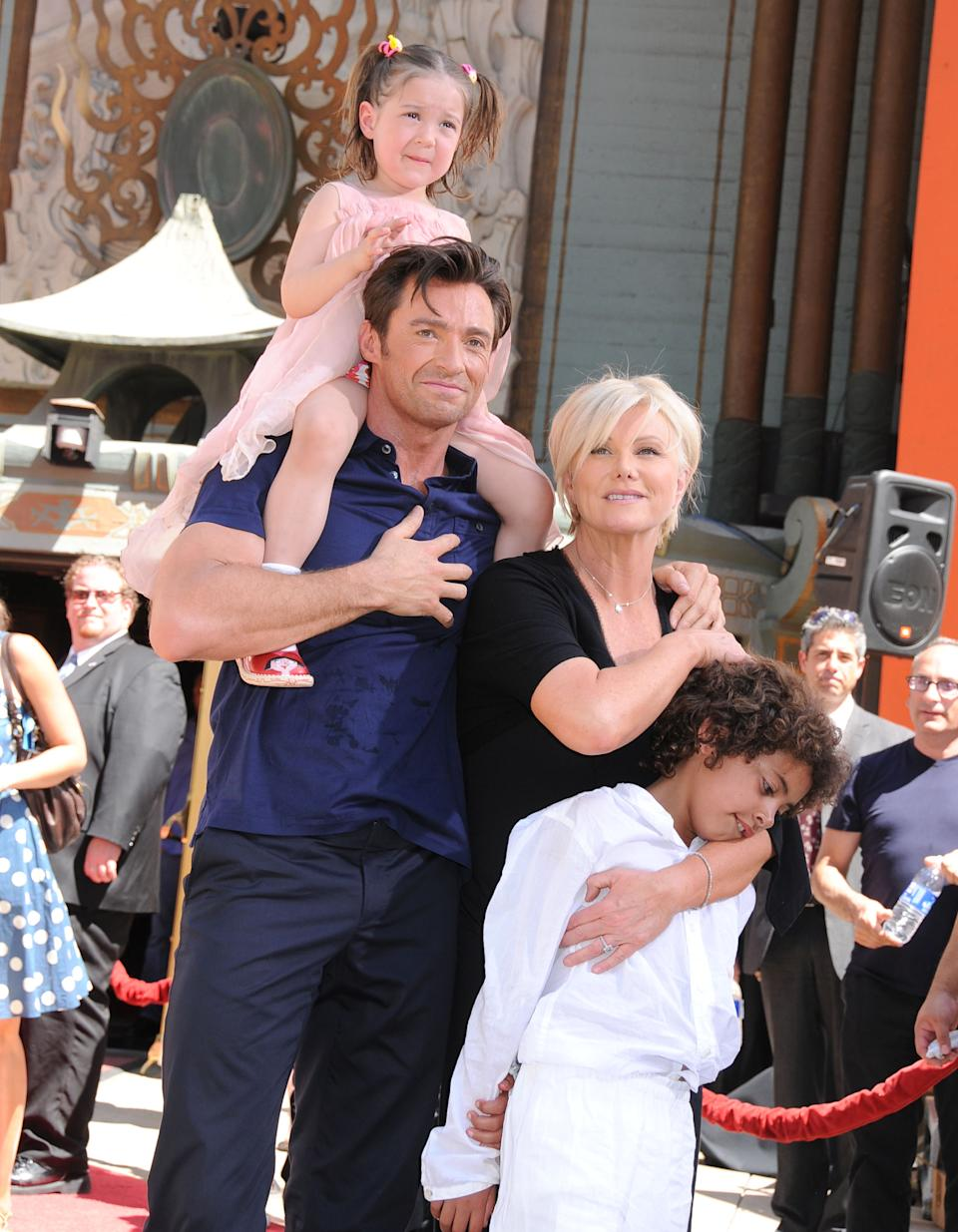 HOLLYWOOD - APRIL 21:  Actor Hugh Jackman, wife Deborra-Lee Furness and their children Ava Jackman and Oscar Jackman attend the handprint and footprint ceremony honoring Hugh Jackman at Grauman's Chinese Theatre on April 21, 2009 in Hollywood, California.  (Photo by Barry King/FilmMagic)