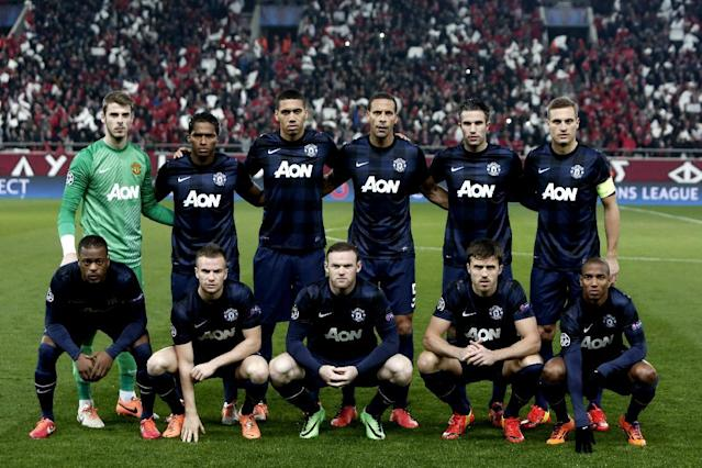 Manchester United's players pose before their Champions League match against Olympiakos at the Karaiskaki Stadium in Athens, on February 25, 2014 (AFP Photo/Angelos Tzortzinis)