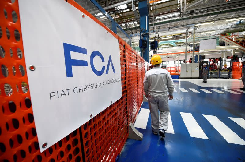 FILE PHOTO: Ceremony to mark the installation of the first robot on the production line for the new electric Fiat 500 BEV at the Mirafiori industrial complex