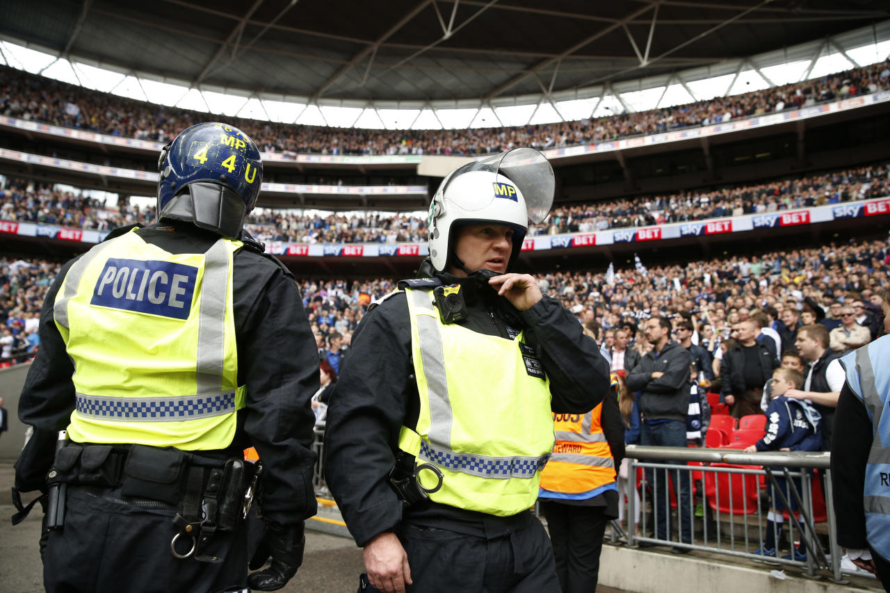 "Britain Football Soccer - Bradford City v Millwall - Sky Bet League One Play-Off Final - Wembley Stadium, London, England - 20/5/17 Police watch fans after the game Action Images via Reuters / John Sibley Livepic EDITORIAL USE ONLY. No use with unauthorized audio, video, data, fixture lists, club/league logos or ""live"" services. Online in-match use limited to 45 images, no video emulation. No use in betting, games or single club/league/player publications.  Please contact your account representative for further details."