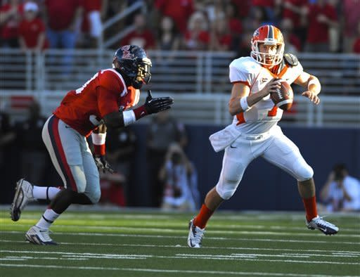UTEP quarterback Nick Lamaison (7) tries to outrun Mississippi defensive end E.J. Epperson during the first half of an NCAA college football game in Oxford, Miss., Saturday, Sept. 8, 2012. (AP Photo/Austin McAfee)