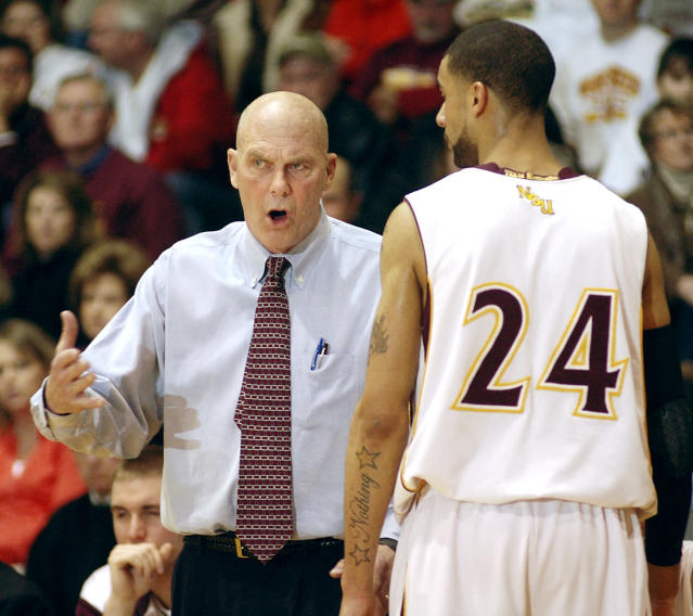 FILE - In this Feb. 27, 2010 file photo, Northern State basketball coach Don Meyer talks with Northern forward Colin Pryor (24) during an NCAA college basketball game against Southwest Minnesota State, in Aberdeen, S.D. Meyer, one of the winningest coaches in college basketball who came back from a near-fatal car accident and liver cancer before closing out his career, died Sunday, May 18, 2014 in South Dakota. He was 69. (AP Photo/Doug Dreyer, File)