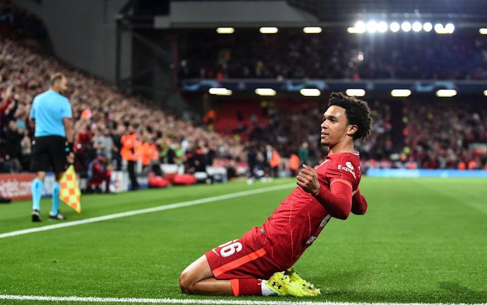 Trent Alexander-Arnold of Liverpool FC celebrates after scoring the opening goal during the UEFA Champions League group B soccer match between Liverpool FC and AC Milan - Shutterstock