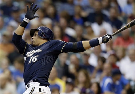 Milwaukee Brewers' Aramis Ramirez watches his three-run home run against the Houston Astros during the third inning of a baseball game Tuesday, July 31, 2012, in Milwaukee. (AP Photo/Jeffrey Phelps)