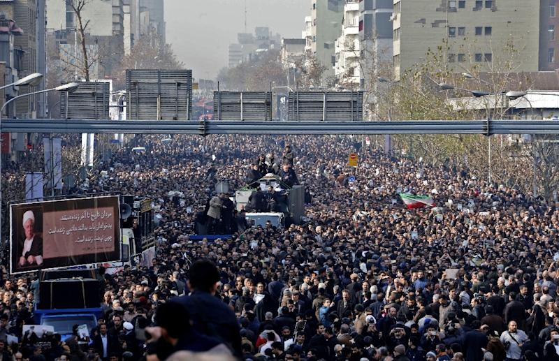 Mourners gather around a hearse carrying the coffin of former president Akbar Hashemi Rafsanjani during his funeral ceremony in the capital Tehran on January 10, 2017