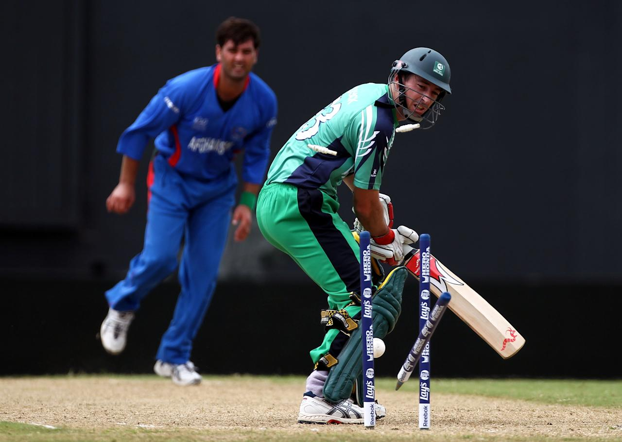 GEORGETOWN, GUYANA - APRIL 28:  Alex Cusack of Ireland is clean bowled by Dawlat Ahmadzai of Afghanistan during The ICC T20 World Cup warm up match between Ireland and Afghanistan at the Guyana National Stadium Cricket Ground on April 28, 2010 in Providence, Guyana. (Photo by Clive Rose/Getty Images)