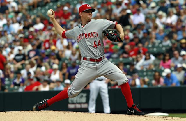Cincinnati Reds starting pitcher Mike Leake works against the Colorado Rockies in the first inning of a baseball game in Denver, Sunday, Sept. 1, 2013. (AP Photo/David Zalubowski)