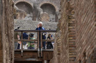 Tod's Diego Della Valle admires the lower level of the Colosseum, in Rome, Friday, June 25, 2021. Italy's culture minister on Friday formally announced the completion of work to shore-up and restore the underground section, in the presence of the founder of Tod's, the shoe-and-luxury-goods maker, who has footed the bill. (AP Photo/Andrew Medichini)