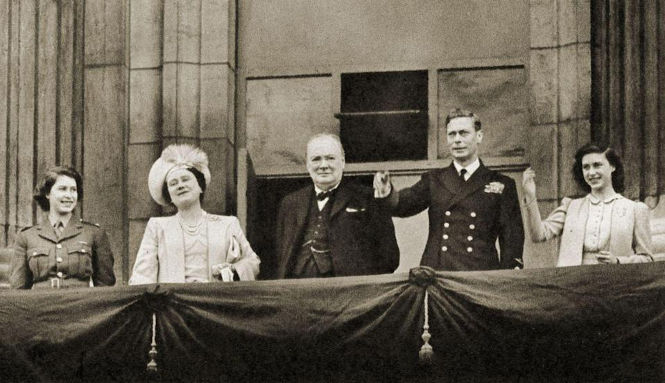<p>Princess Elizabeth, Queen Elizabeth, Winston Churchill, King George VI, and Princess Margaret wave from the balcony of Buckingham Palace.</p>