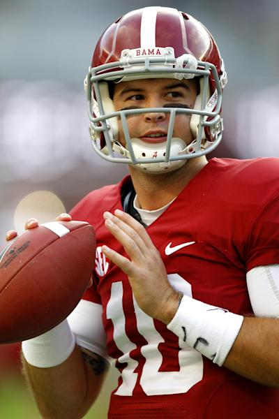 Alabama quarterback AJ McCarron (10) throws a pass before the first half of an NCAA college football game against Arkansas on Saturday, Oct. 19, 2013, in Tuscaloosa, Ala. (AP Photo/Butch Dill)