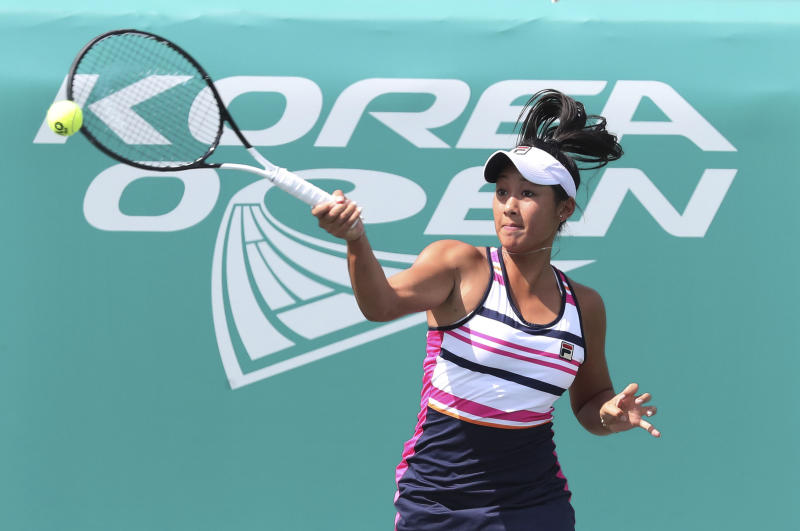 Priscilla Hon of Australia returns a shot to her compatriot Ajla Tomljanovic during their second round match of the Korea Open tennis championships in Seoul, South Korea, Thursday, Sept. 19, 2019. (AP Photo/Ahn Young-joon)