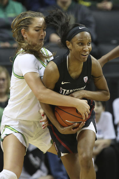Oregon's Taylor Chavez, left, and Stanford's Kiana Williams struggle for the ball during the second quarter of an NCAA college basketball game in Eugene, Ore., Thursday, Jan. 16, 2020. (AP Photo/Chris Pietsch)